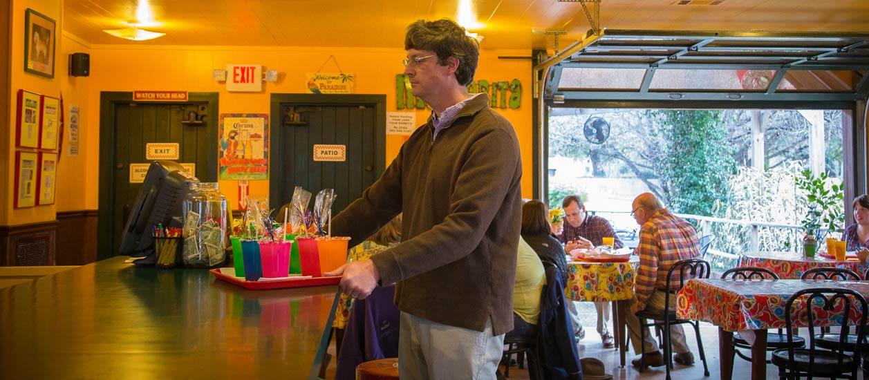 man getting order at Fat Mama's Award-winning Knock You Naked Margaritas | Order Online | Fat Mama's Tamales | Natchez, MS