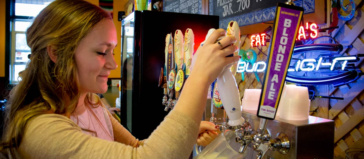 Fat Mama's Tamales co-worker pulling a draft beer | Order Tamales Online | Fat Mama's Tamales | Natchez, MS