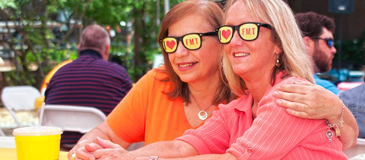 two ladies with I Love FMT sunglasses | Order Tamales Online | Fat Mama's Tamales | Natchez, MS
